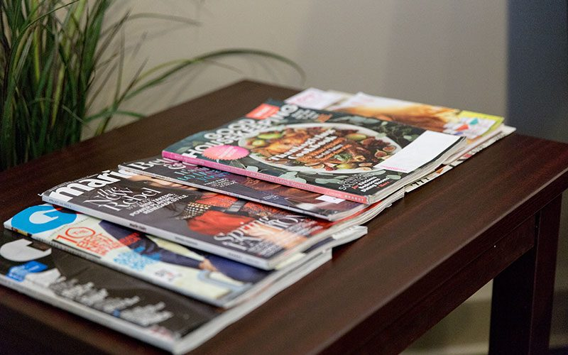 Magazines on the Table of Hawkins Complete Dental Service in Zanesville, OH