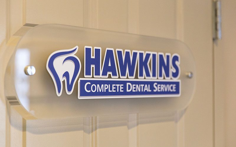 Hawkins Complete Dental Service Signage on the Door in Zanesville, OH